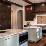 Dark wood cabinets with beautiful tile backsplash