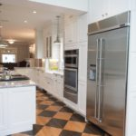 White shaker cabinet kitchen with stainless steel appliances
