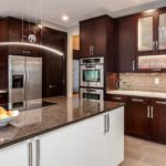 Dark wood minimal cabinets with large center island