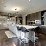Black wood cabinet kitchen with island and stove hood
