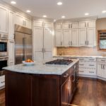 Off white cabinets with marble countertops