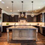 Dark wood cabinet kitchen with large center island