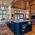 Blue painted cabinets with large center island
