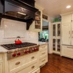 Off white painted cabinets with marble countertop