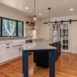 White cabinet kitchen with blue painted island