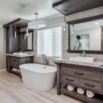 Master bath with custom built in vanities in natural wood