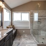 Master bath with granite vanity and glass shower