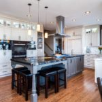 White painted cabinets with grey island