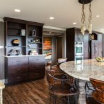 Dark wood kitchen with light granite center island