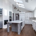 White painted kitchen cabinets with light grey painted island