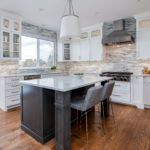 white painted cabinet kitchen stained island